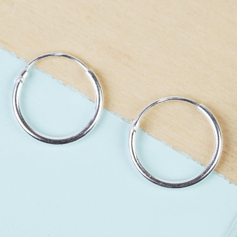 Hoop Earrings. We've got a hoop style to suit any earring wearer. Tiny and discreet silver hoop earrings, glamorous statement hoops, and even hoops in fun shapes and colours to add an extra pop to your accessories collection.