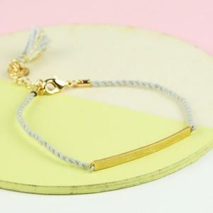 Brushed Gold Curved Bar and Grey Cord Bracelet