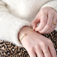 Model Wears Lisa Angel Personalised Adjustable Hug Hands Bangle